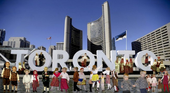 "A wonderful sight to behold on Estonia's 100th birthday on February 24th 2018 would be children in Estonian folk costumes skating at Nathan Phillips Square ice rink and posing for photos in and on the TORONTO sign with the ""sini-must'valge"" flying in the background. …..weather permitting of course!"