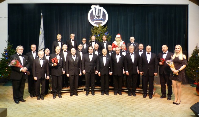 The Toronto Estonia Mens' Choir, at their annual Christmas concert, presents traditional songs of the holidays as well as a roader repertoire. Augmenting the full choir is an ensemble with appropriate head-geared, boosting the Christmas spirit in full-throated form. Photo via Andres Raudsepp (2019)
