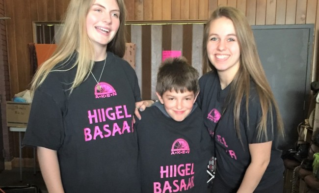 First-time volunteers at Hiigelbasaar #26: in the middle, youngest volunteer Stephane Perron, on the right footwear department whiz-kid Kariina Järve and on the left rummage sale enthusiast and Girl Guide Sylvi Oja.