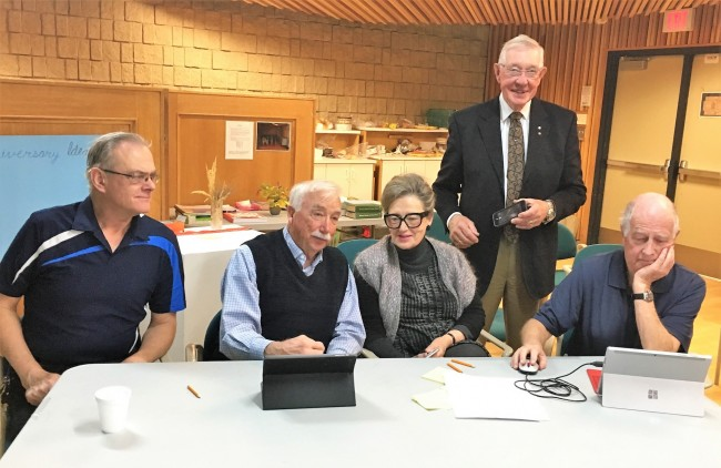 This team is deep in thought looking for ways to find information on the newly revised Alberta Estonian Heritage Society website at its grand relaunch in Red Deer, Alberta, October 2017. Team members seated L to R: John Erdman, Bob Tipman, Hazel Flewwelling, Peeter Leesment, standing Morris Flewwelling. Photo: Schuler pere/family (2017)