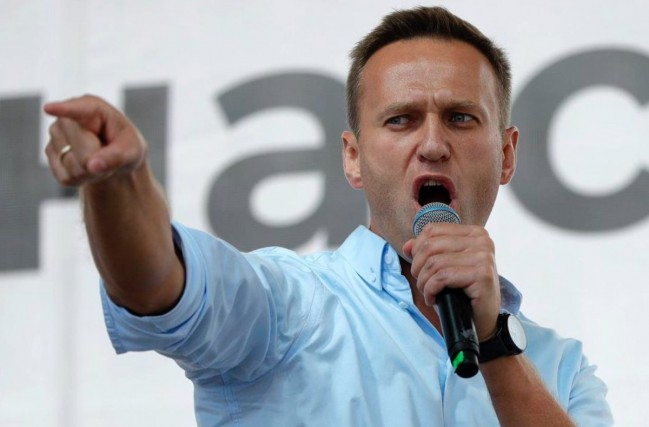 In this July 20, 2019, file photo, Russian opposition activist Alexei Navalny gestures while speaking to a crowd during a political protest in Moscow. Berlin's Justice Ministry has approved a request from Moscow for legal assistance in the investigation of the poisoning of Navalny, and has tasked state prosecutors with working with Russian authorities.  PAVEL GOLOVKIN / AP