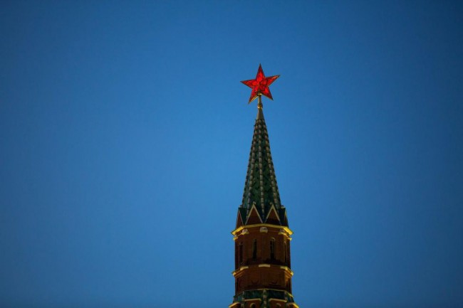 "An illuminated red star sits on display above one of the Kremlin towers in Moscow in April. ""It would be hard to imagine that the trolls who operate out of the Kremlin's internet Research Agency ... are using the Kremlin credit card and billing address when they pay their social media advertising,"" writes Marcus Kolga.  (ANDREY RUDAKOV / BLOOMBERG)"