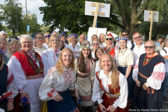 Members of the Estonia Choir at this summer's 150th Anniversary of Estonia's Song and Dance Festival inn between singing with about 25,000 other choristers under the huge band shall in Tallinn. Photo by Peeter Põldre (2019)