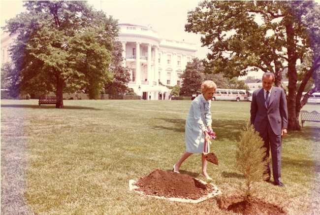 President Richard Nixon and First Lady Pat Nixon plant a tree on the White House South Lawn to recognize the first Earth Day.