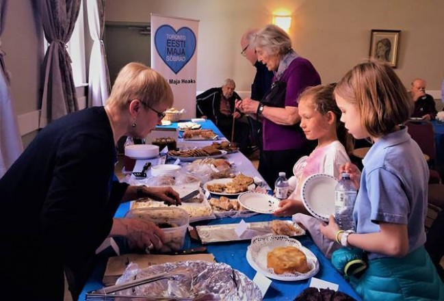 Happy customers enjoying the bake sale at last year's AKEN and Friends' BLUE-BLACK-WHITE SALE and Café. Please come and join us this year in the Grand Hall and enjoy performances too. You can help by baking, donating Estonian themed items and/or being part of the sales team. Don't miss this year's event!
