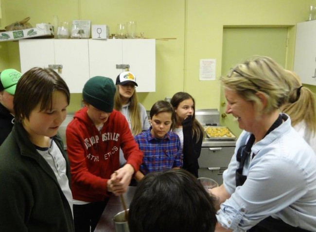 Susi Holmberg cooking with students at Estonian House kitchen - photo by Kai Kiilaspea (2015)