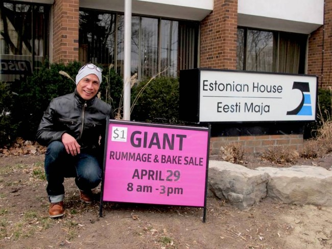 """The bright pink Rummage Sale sign in front of Esto House is very eye-catching. It immediately drew the attention of Raymond, who had brought his daughter Rayanna to the Estonian House on Saturday March 11th to participate in a girls kickboxing competition billed as """"She Fights"""". Judging from the number of people present at Esto House for this competion, kickboxing is apparently a very popular sport among young girls - photo by Maaja Matsoo"""