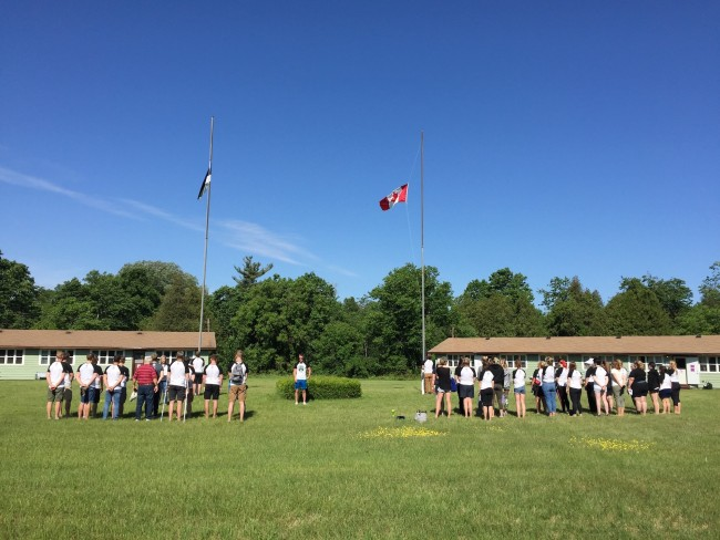 Each day at JK Alumni Laager begins with the formal flag raising on the camp's parade ground. A sunny day helps ensure sunny dispositions among all the campers.  Photo credit:  Kristina Põldre (2018)