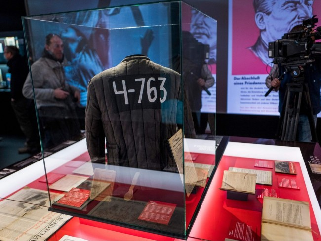 """In this Jan. 23, 2018 file photo, a padded jacket, traditionally worn by prisoners in the Soviet Gulag labour camp system, is on display next to a wooden spoon dubbed as """"Stalin ladle"""" at the """"Stalin - The Red God"""" exhibition at the Berlin-Hohenschoenhausen memorial. PHOTO BY JOHN MACDOUGALL /AFP via Getty Images / torontosun.com"""