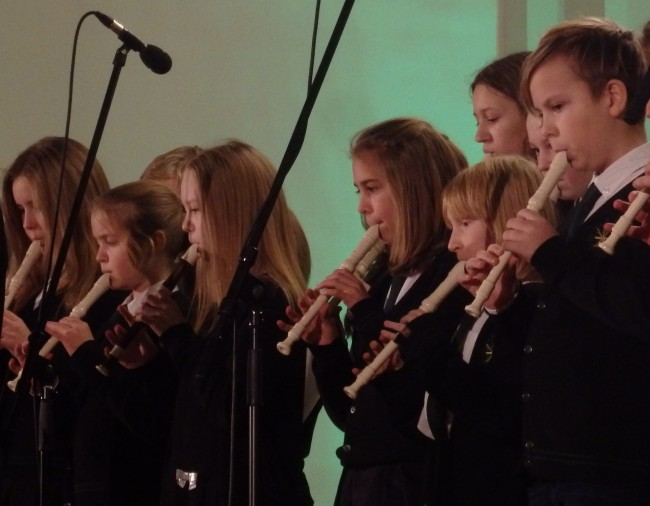 Kaarli Kooli 5th graders playing the soprano plokk/flööt (recorder) at the school's advendi/kontsert at Kaarli kirik, Tallinn's only twin-towered church, standing just beyond the Old Town and named after King Karl XI of Sweden. From the left are Emma, Lotta, Marii, Susi, Hanna-Loore (back row, grade 6), Mirtel, Karolina (6. klass) and Juhan. The plokkflööt is in fact far from new, it's the original Western flööt, at least in its solid wooden form; today many recorders are made from moulded resin. The light-coloured pillid (musical instruments) featured here are made of resin, not elevandi/luu (ivory), as desired by royalty and aristocrats during the renessanss period. Photo: Riina Kindlam (2018)