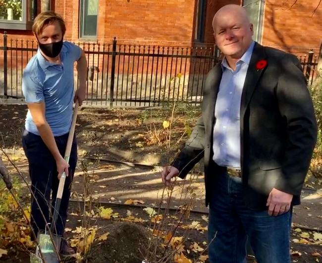 Veiko Parming, President of Estonian House and Chair of International Estonian Centre, left, and David Kalm, IEC Project Manager, right, planting the birch trees.