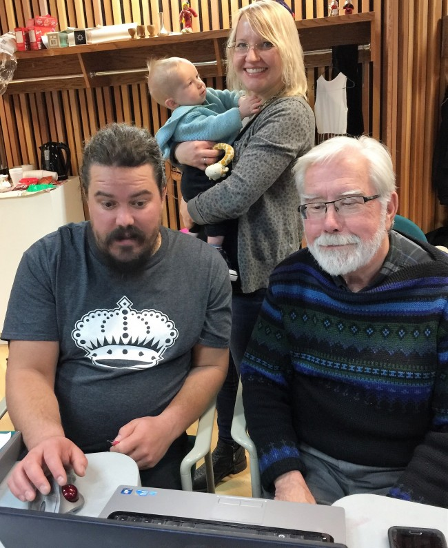 One of the teams vying to be the first to discover the answer to a scavenger-game question on the revised website of the Alberta Estonian Heritage Society at its Fall Social. At the front Scott Raabis and Toomas Paasuke, with Kathleen Renne and her nephew also participating. Photo: Schuler family/pere (2017)